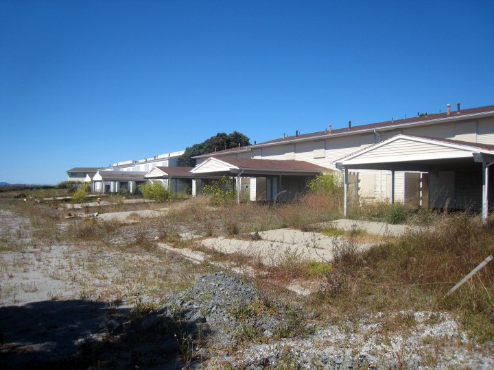 Abandoned housing on contaminated soil